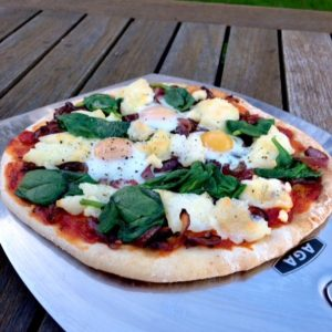 Pizza with Caramelised Onions, Goats Cheese, Spinach & Quails Eggs